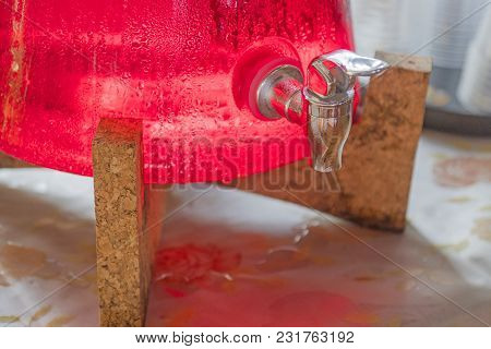 Red Nectar Is In The Container And The Faucet.
