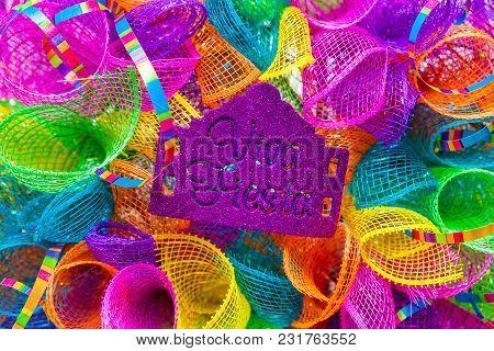 The Word 'viva Fiesta' Written In Purple Glitter On Multicolored Mash Decorated