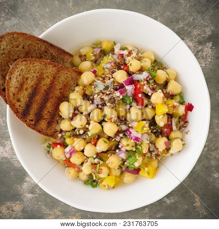 Vegan Quinoa Salad With Chickpeas And Bread.
