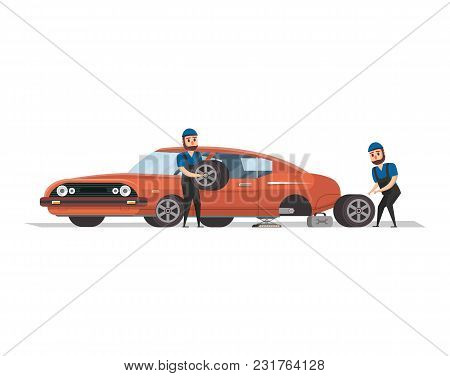 Two Professional Mechanics In Uniform Working With Red Muscle Car And Replacing The Wheel.