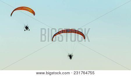 Para-motor flying in the sky Paragliders Soar through