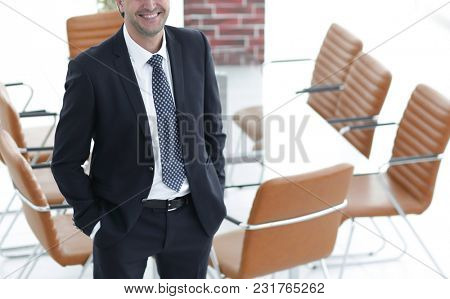Business man standing in an empty meeting room