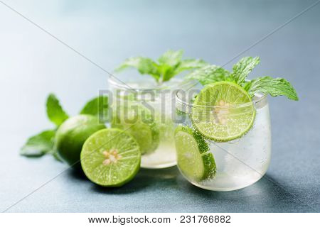 Glass Of Iced Lemonade Soda With Slice Lime And Mint Leaves, Cold Drink In Summer