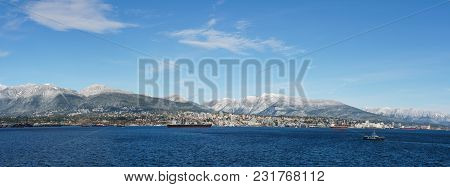 Vancouver, Canada - February 18, 2018: Busy Harbour With North Vancouver On Background Sunny Day