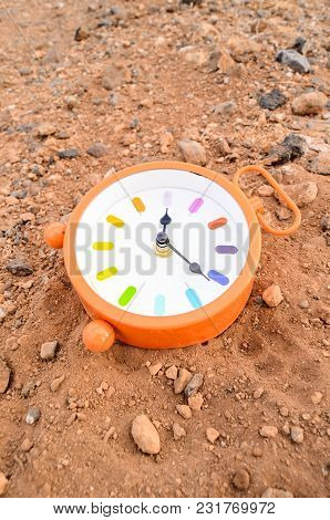 Classic Analog Clock In The Sand On The Rock Desert