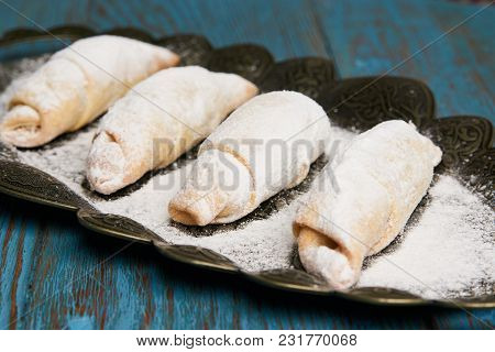 Mutaki Cookies Rolled With Powdered Sugar On Copper Tray On Rustic Wooden Table, Turkish Food