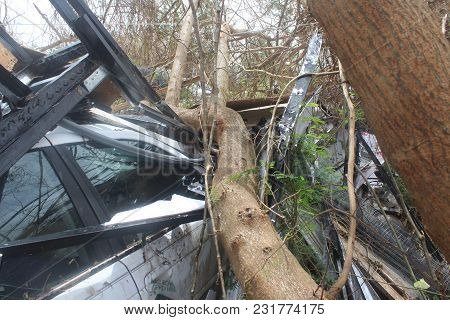 A Vehicle Buried After A Category 5 Hurricane Debris