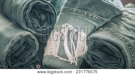 Jeans On A Wooden Background