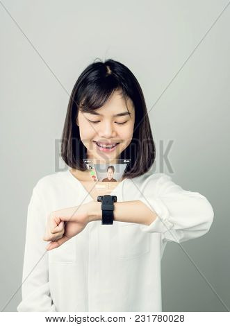 Woman In A White Dress Show Digital Clock Displaying Digital Screens To Communicate Face-to-face. Th