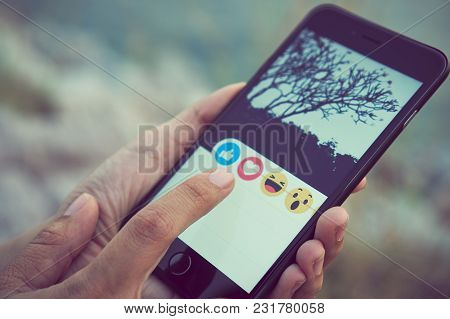 Bangkok, Thailand - March 19, 2018 : Women Hand Is Pressing The Facebook Screen On Apple Iphone6 On