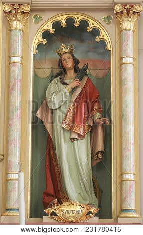 SISAK, CROATIA - DECEMBER 07: Statue of Saint Catherine of Alexandria on the altar of Our Lady in the Church of Holy Cross in Sisak, Croatia, on December 07, 2017.