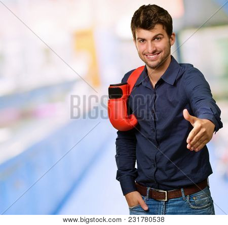 Portrait Of Happy Man With Gloves And Gesturing, Indoors