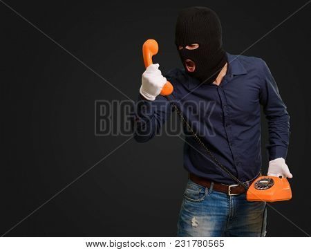 Burglar Man Shouting On Telephone On Black Background
