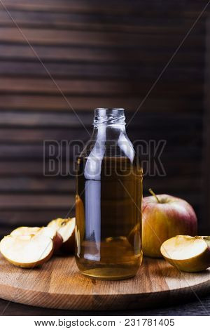 Fresh Apple Drink In A Glass Bottle Wooden Background