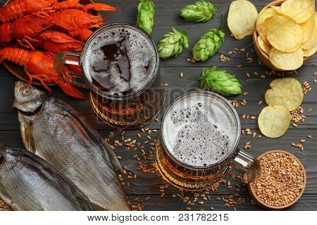Glass Beer With Crawfish, Dried Fish And Hop Cones On Dark Wooden Background. Beer Brewery Concept.