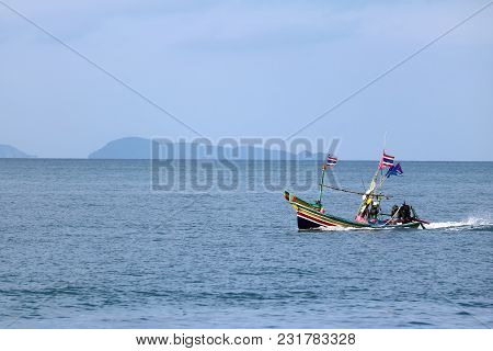 Local Fishing Boat With Long-tail Engine Running In The Sea, Gulf Of Thailand