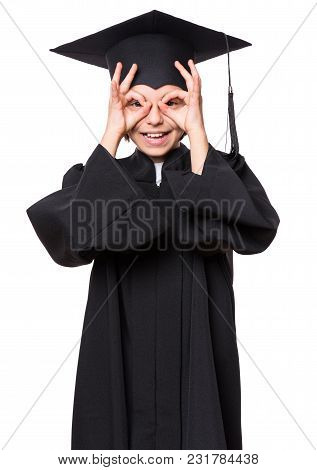 Graduate Little Happy Girl Student In Black Graduation Gown With Hat Showing Ok Gesture - Isolated O