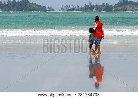 Father And Kid Holding Hands Together,walking On Tropical Beach Paradise In Kudat,sabah,malaysia Wit