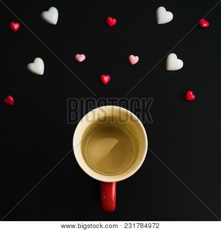 A Blank Red Cup With Floating Heart On Dark Background.happy Valentines Day Background. Can Be Used