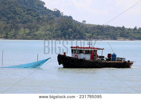 Towing Boat Or Cargo Ship Moving Near The Shore ,transportation And Industrial Gulf Of Thailand