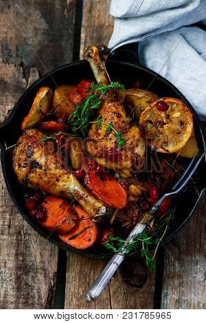 Skillet Cranberry Roasted Chicken And Potatoes.style Rustic.selective Focus