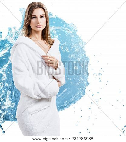 Young Sensual Woman In Bathrobe In Water Splashes. Over White Background.