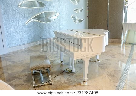 White Piano In A White Interior And Luxury Room. Grand White Piano.