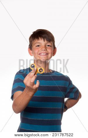 Boy With Fidget Spinner Posing In A Funny Way.