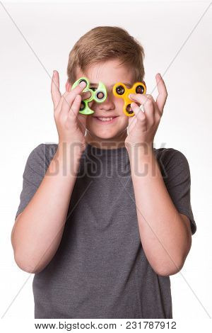 Boy With Fidget Spinners Posing In A Funny Way.