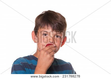 Boy Eating A Strawberry And Raising His Eyebrows. White Background.