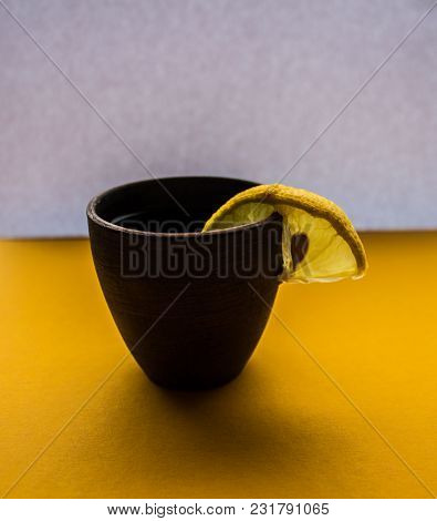 A Alcoholic Drink With Lemon On White Background