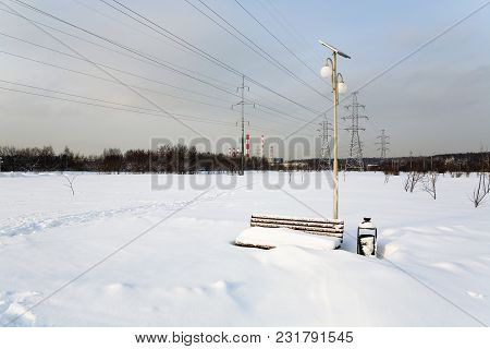 The Bench Is Covered With A Thick Layer Of Snow. Winter In Russia.