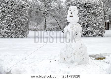 Ugly Snowman In Unterschleissheim By Munich, Germany.