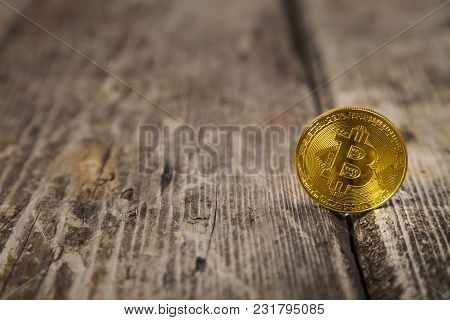 Bitcoin On An Old Wooden Table. Сoncept Of E-commerce.