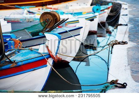 Small Motor Boats Tied To Pier With Ropes. Rent Boat For Summer Vacation Travel To Exotic European I