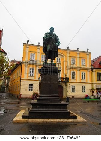 Hungary, Gyor - August 31, 2014: The Statue Of Kisfaludy Karoly On Vienna Gate Square In Gyor On An