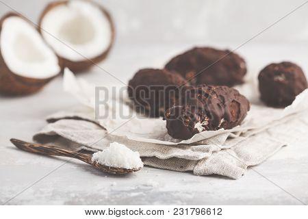 Raw homemade vegan chocolate coconut dessert bounty. Healthy vegan food concept. poster