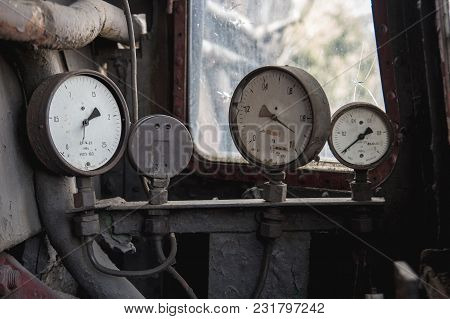 Three Old Broken Pressure Gauge At An Old Abandoned Oil And Gas Distribution Station