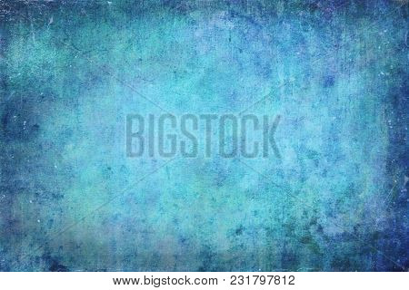 A grainy mottled blue distressed background. Suitable for overlays.