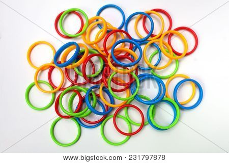 Multicolor Colorful Plastic Rings On White Background