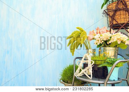 A Beautiful Bouquet Of Artificial Flowers And Real Flowers In A Bucket On A Steel Chair And A Basket