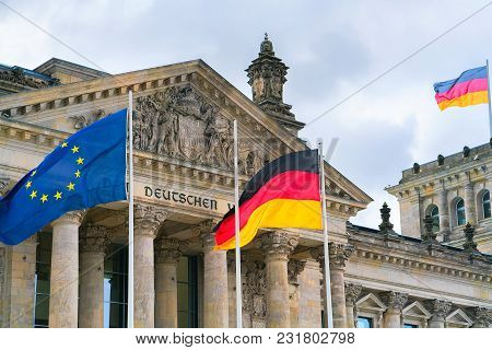 Berlin, Germany - December 8, 2017: Detail Of Reichstag Building And German And Eu Flags In Berlin,