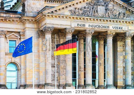Berlin, Germany - December 8, 2017: Detail Of Reichstag Building And German And Eu Flags, In Berlin,