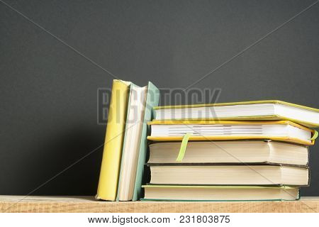 Stack Of Books On Black Background. Copy Space For Text. Back To School. Education Concept.
