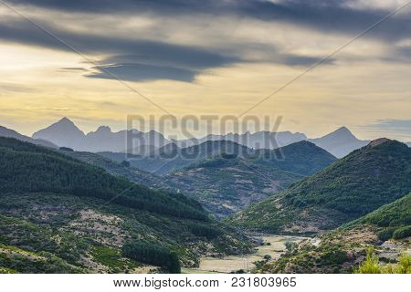 Beautiful Landscape In Spain With Dramatic View Of Cantabrian Mountains. Power Line Running Along Th