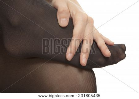 Close-up Of Female Foot With Pantyhose. Woman Is Rubbing Her Toes To Relax Pain.