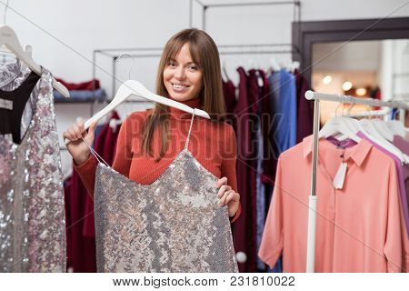 Young girl with a dress in the shop