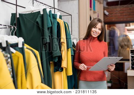 Young smiling girl at work in the store