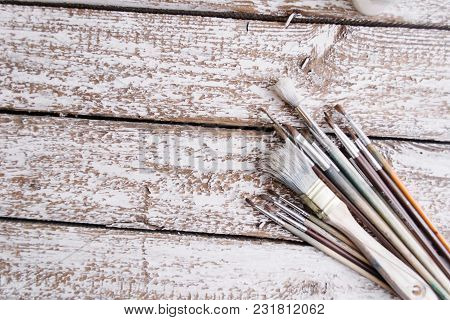 Brushes On A Wooden Painted White Background