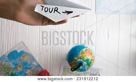 A Man Is Holding A Paper Airplane In His Hand. Still Life Of A Traveler